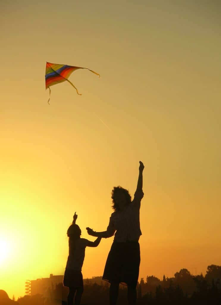 mother son playing kite