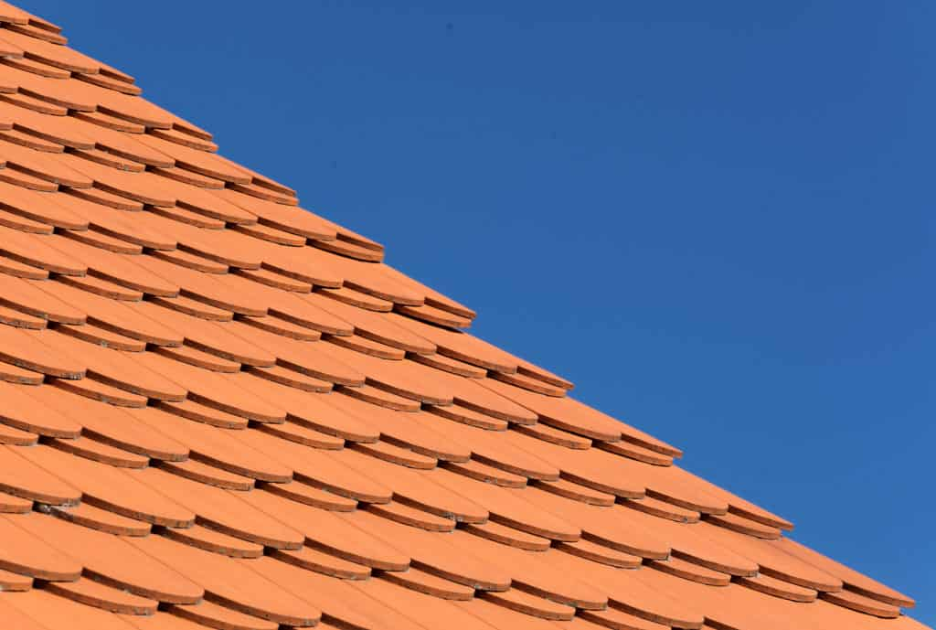 orange clay tile roof and blue sky